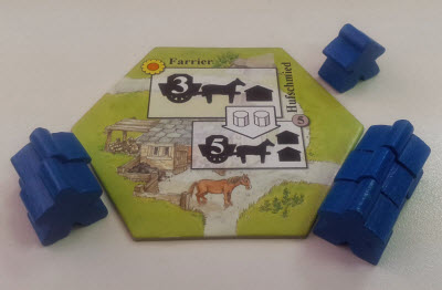 Here, players bid for the Farrier. The first player used Blue workers, so only Blue may be used. Another player is currently winning the bid with three.