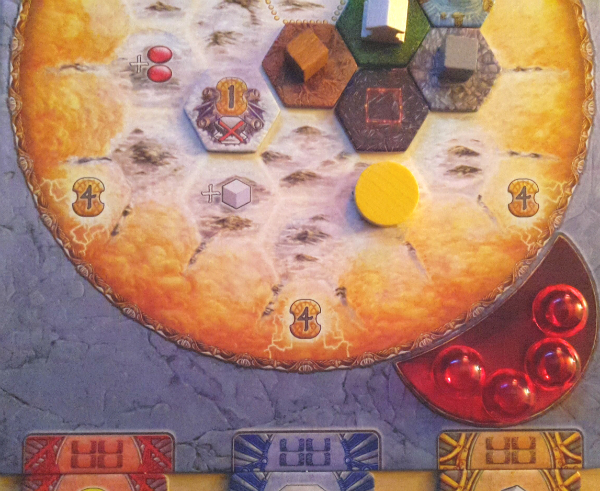 At this point in the game, the player has at least one Action tile of each color, four Mana, five Earth tokens and a Bonus token on their board.