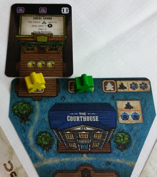 Last round the Blue player bought the Lodge. The following round it's ability was used by Yellow. Prototype Shown