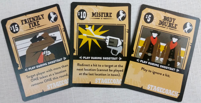 Boomtown Bandit cards, both with an single-use ability and a dollar value.
